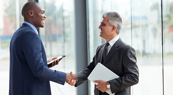 Image of Two Businessmen Shaking Hands