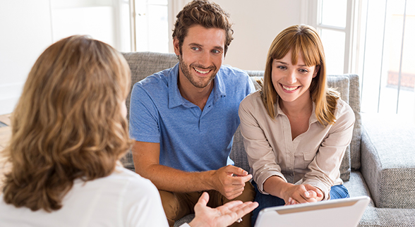 Image of Couple Talking with a Finance Professional