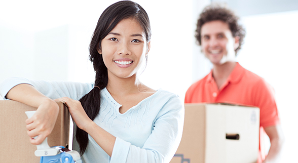 Image of Couple Packing Their Things