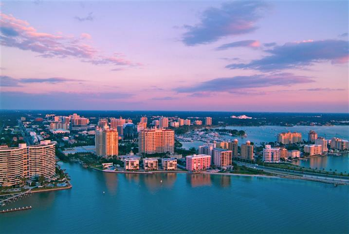 Downtown Sarasota skyline with bay at dusk