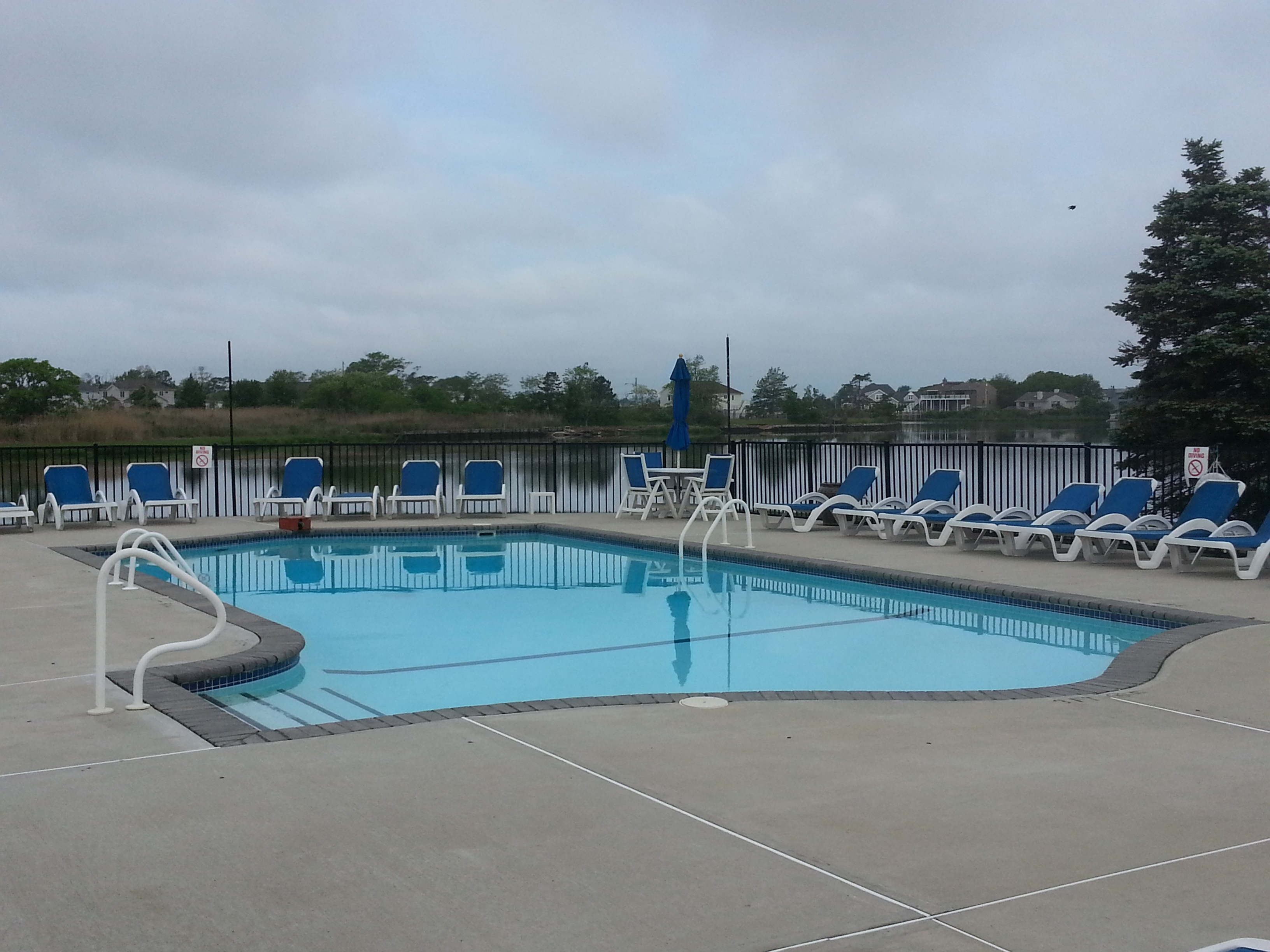 The Sands Point South community pool overlooks the river.