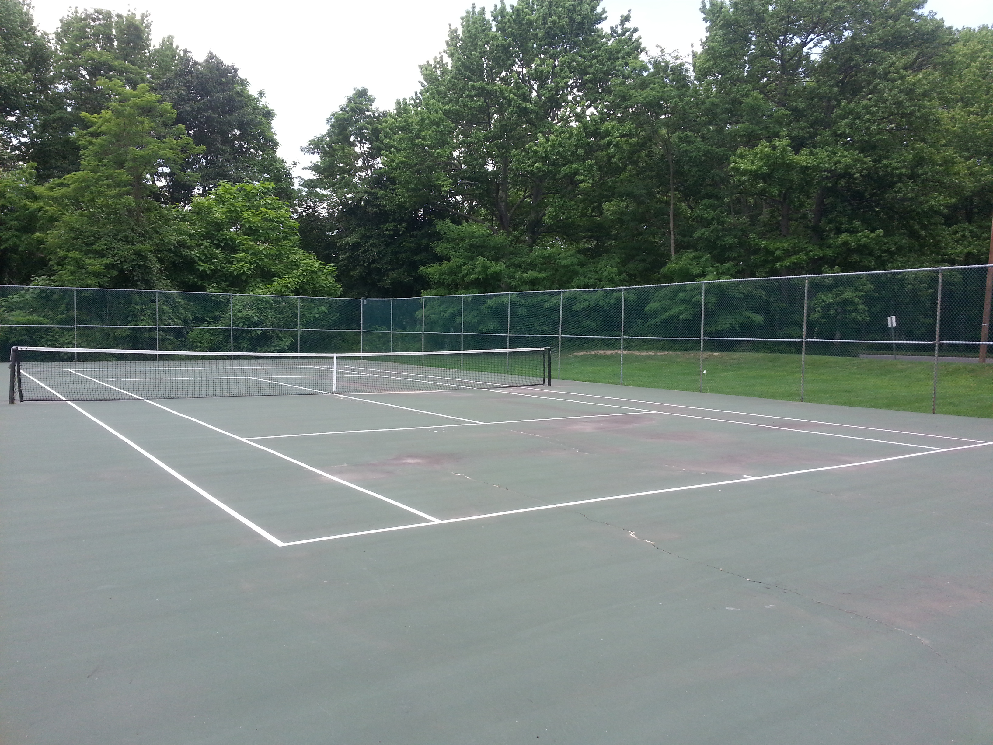 Tennis anyone?  In addition to a pool, Kimberly Woods has a tennis court.