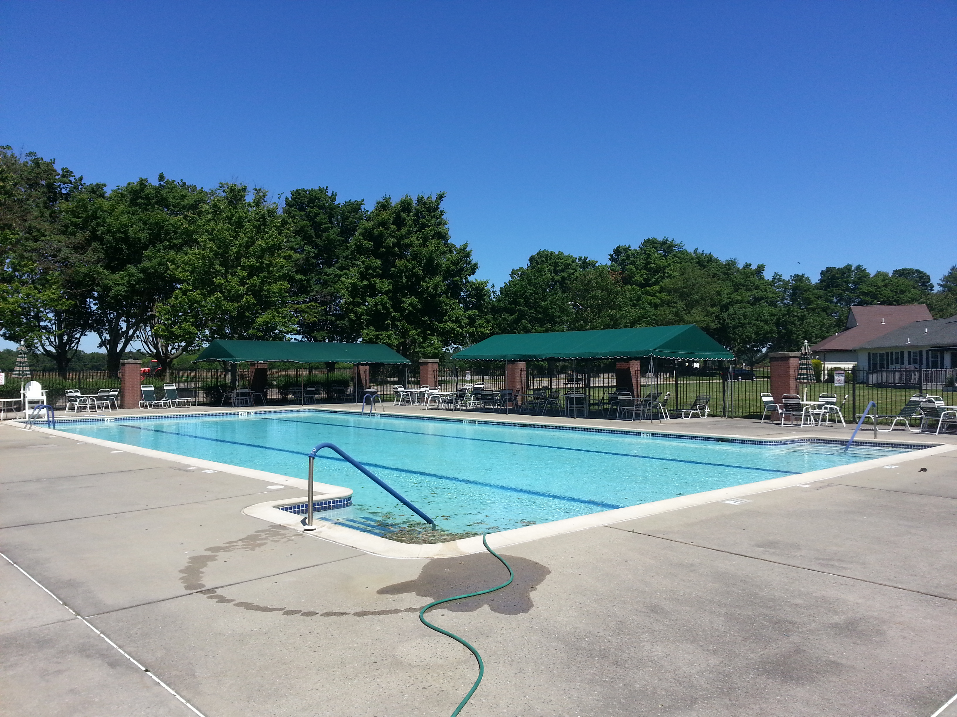 The community pool located by the recreation building is the focal point of the summer social scene.