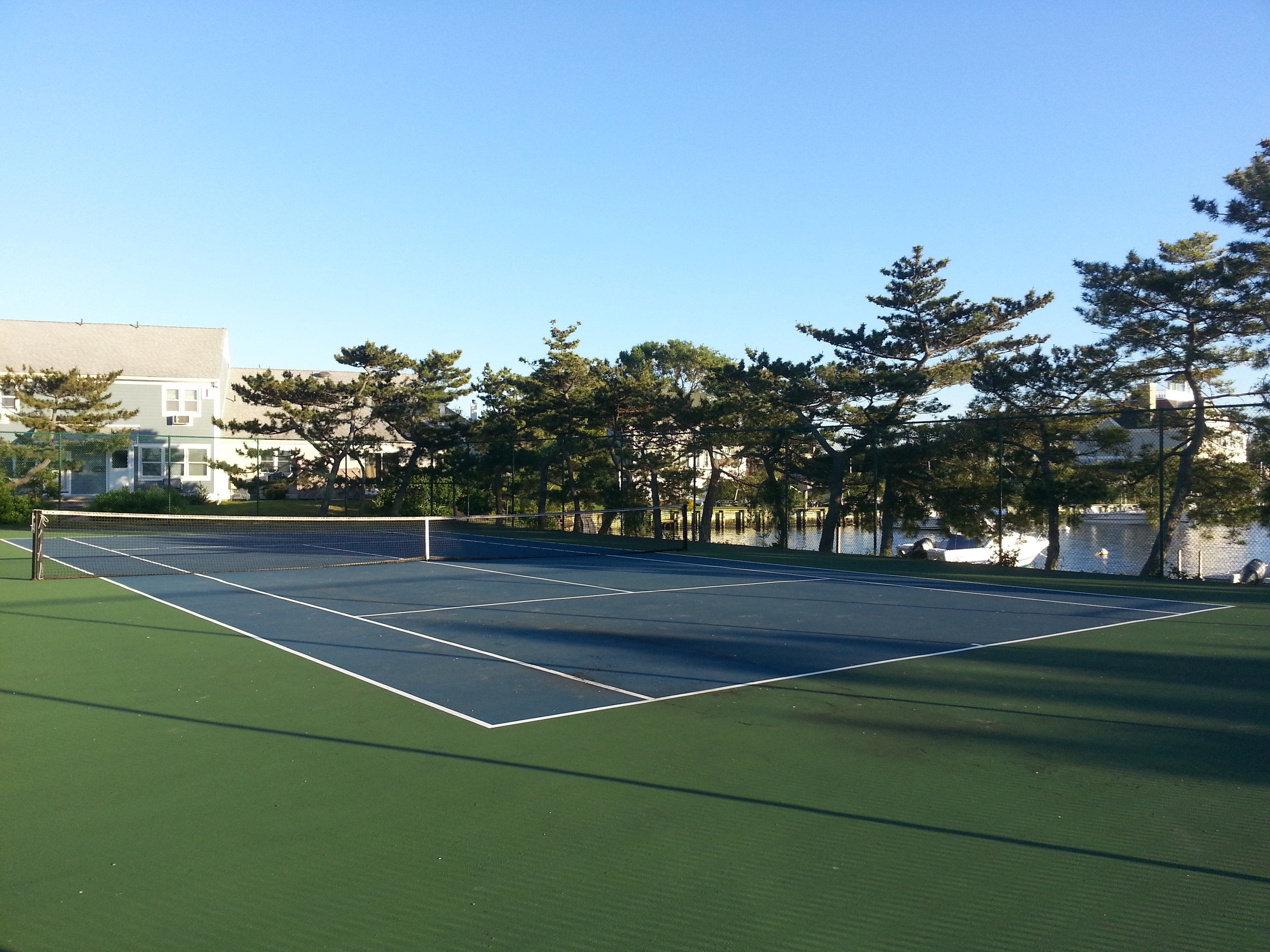 The Breakwater Cove tennis courts is next to the river, making it a cooler place to play.