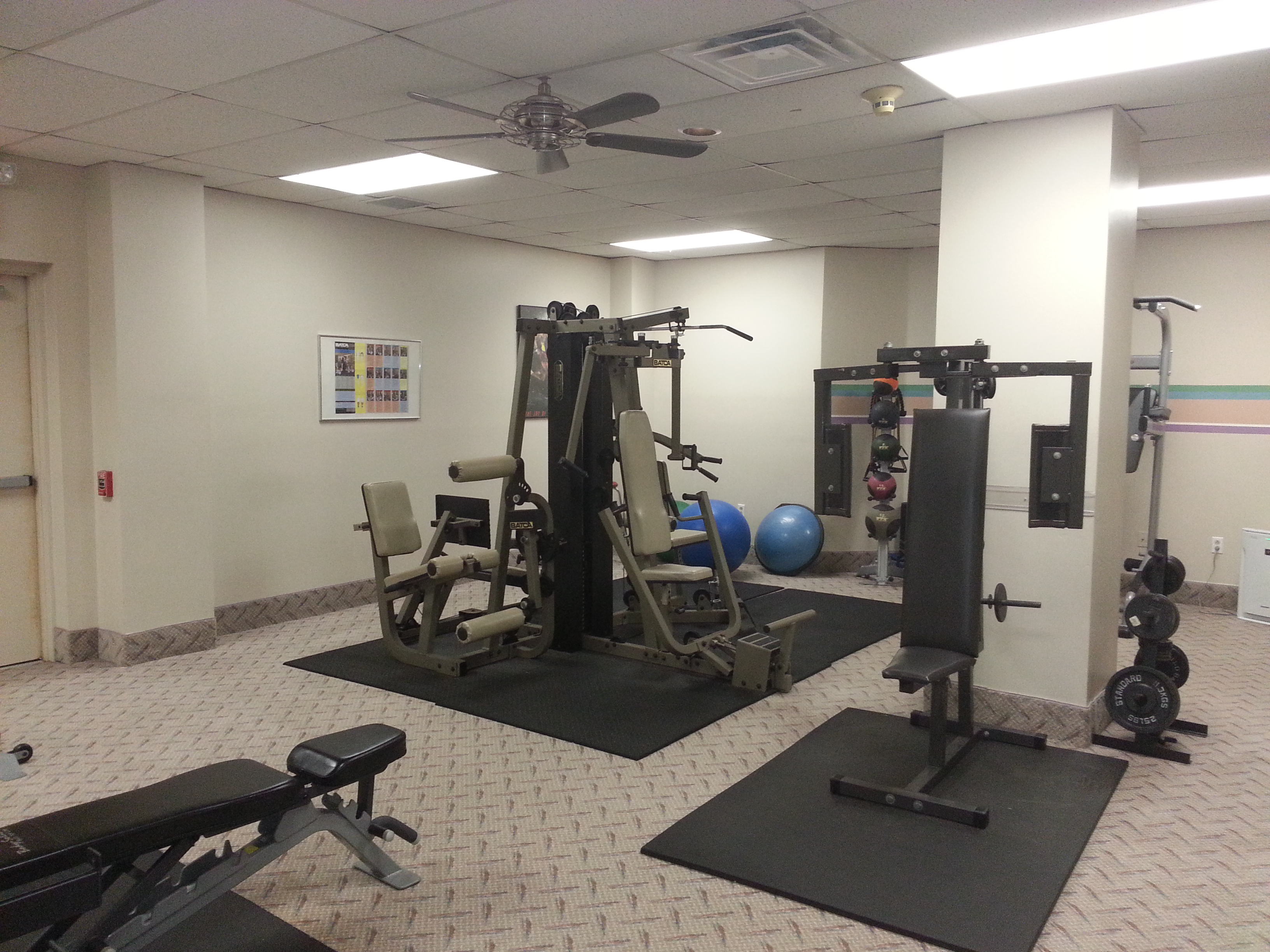 The fitness room has free weights and weight machines plus his/hers lockers and showers.