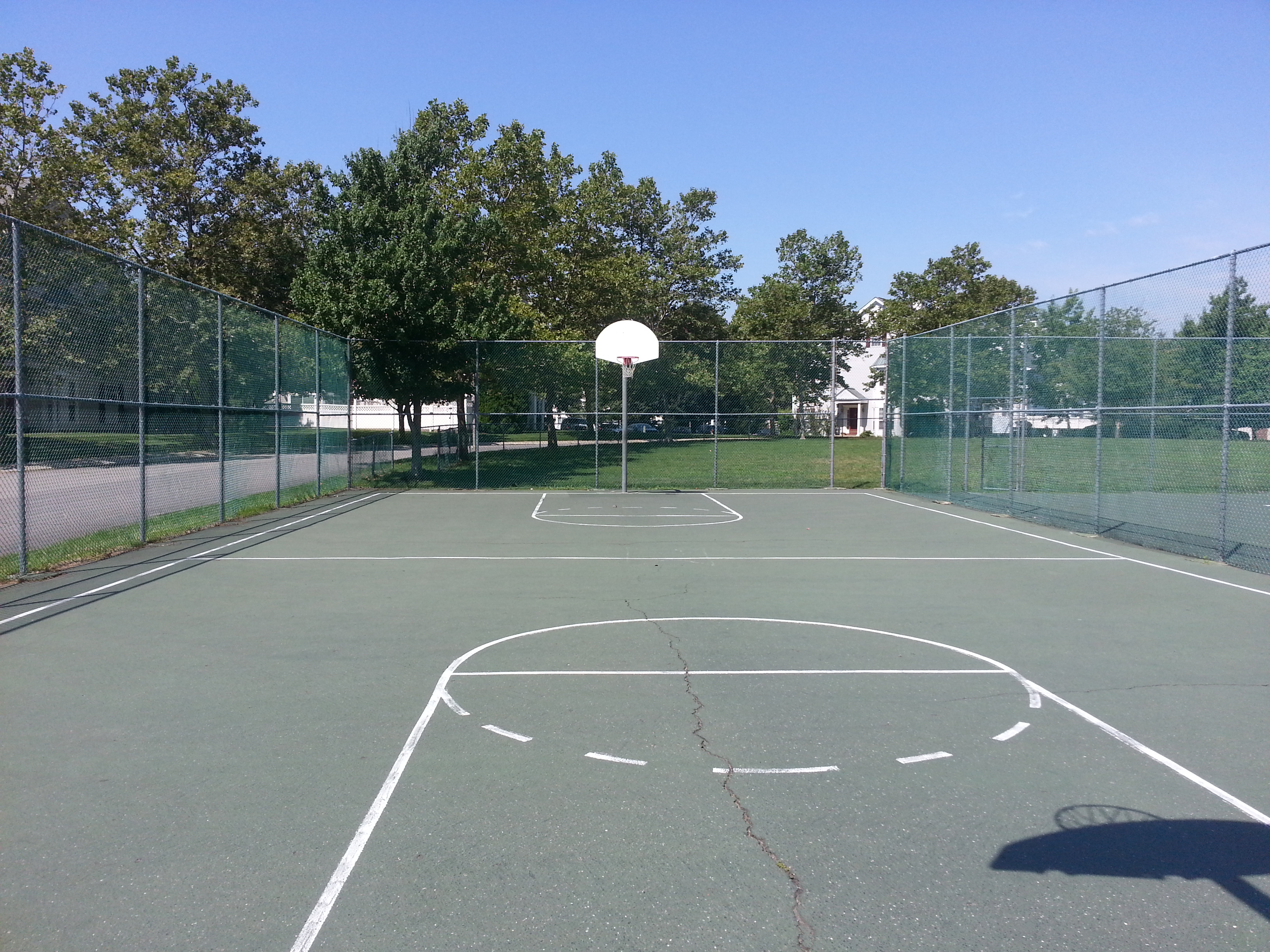 Next to The Orchards tennis court is this basketball court.