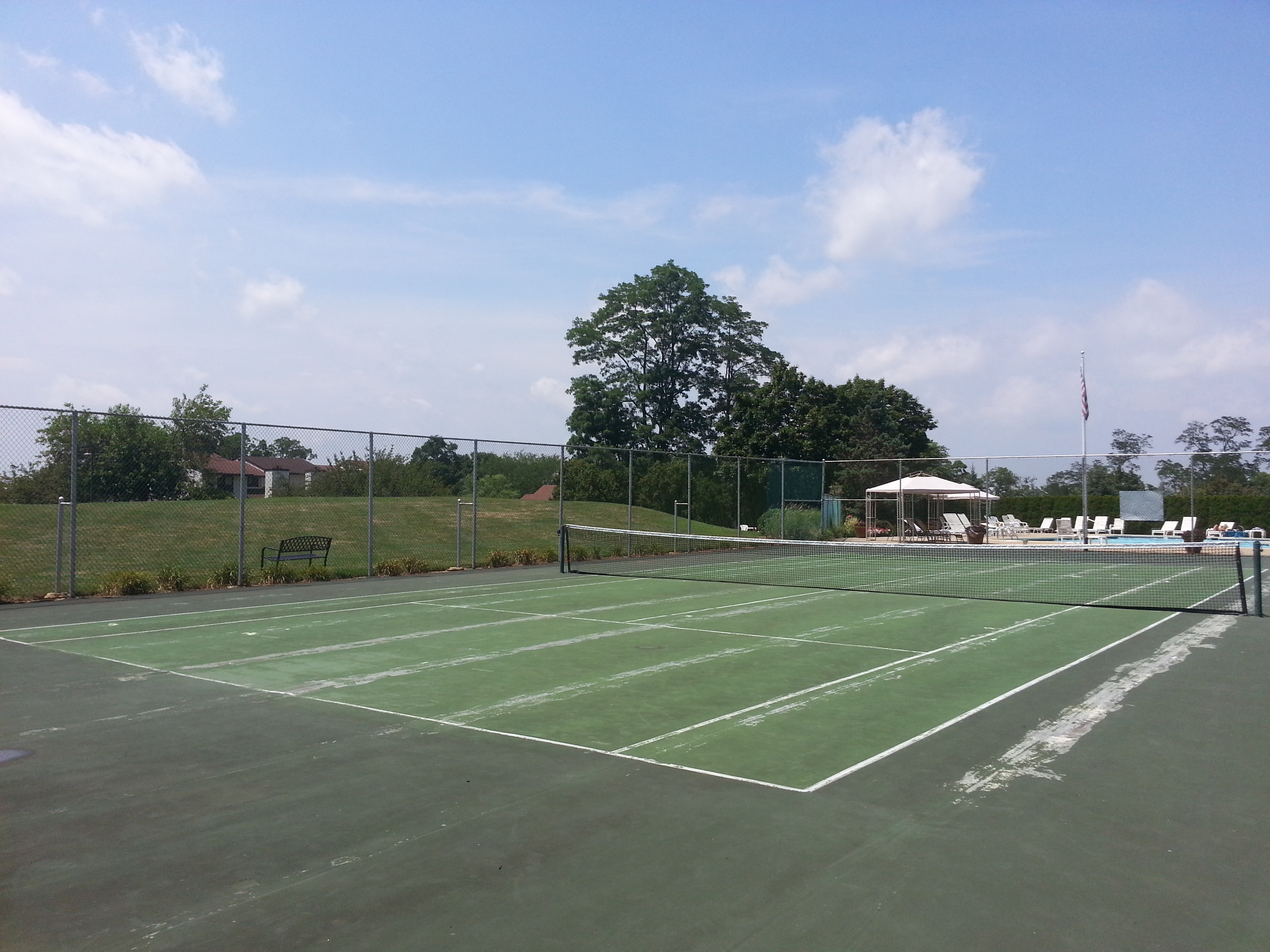 Located next to the pool, this tennis court is another of the Tower Hill amenities.