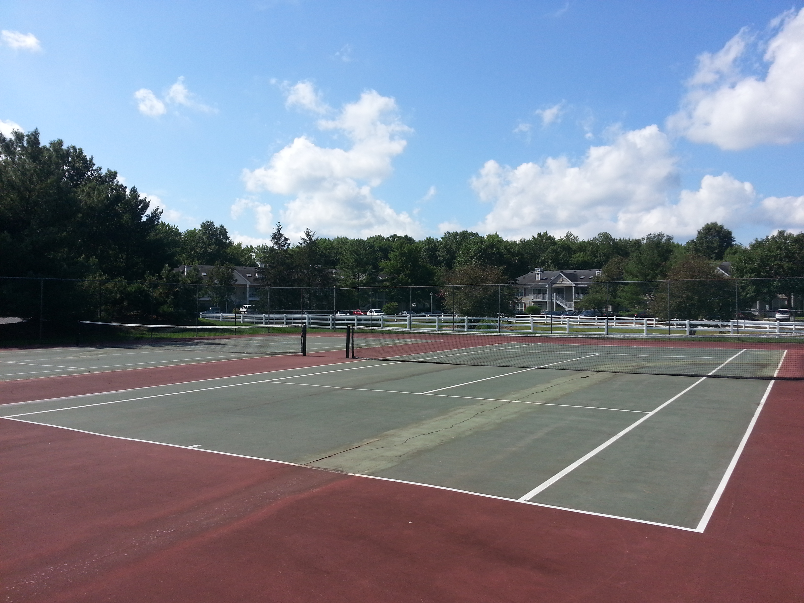 Society Hill at Tinton Falls has two tennis courts, pictured here, among the community amenities.