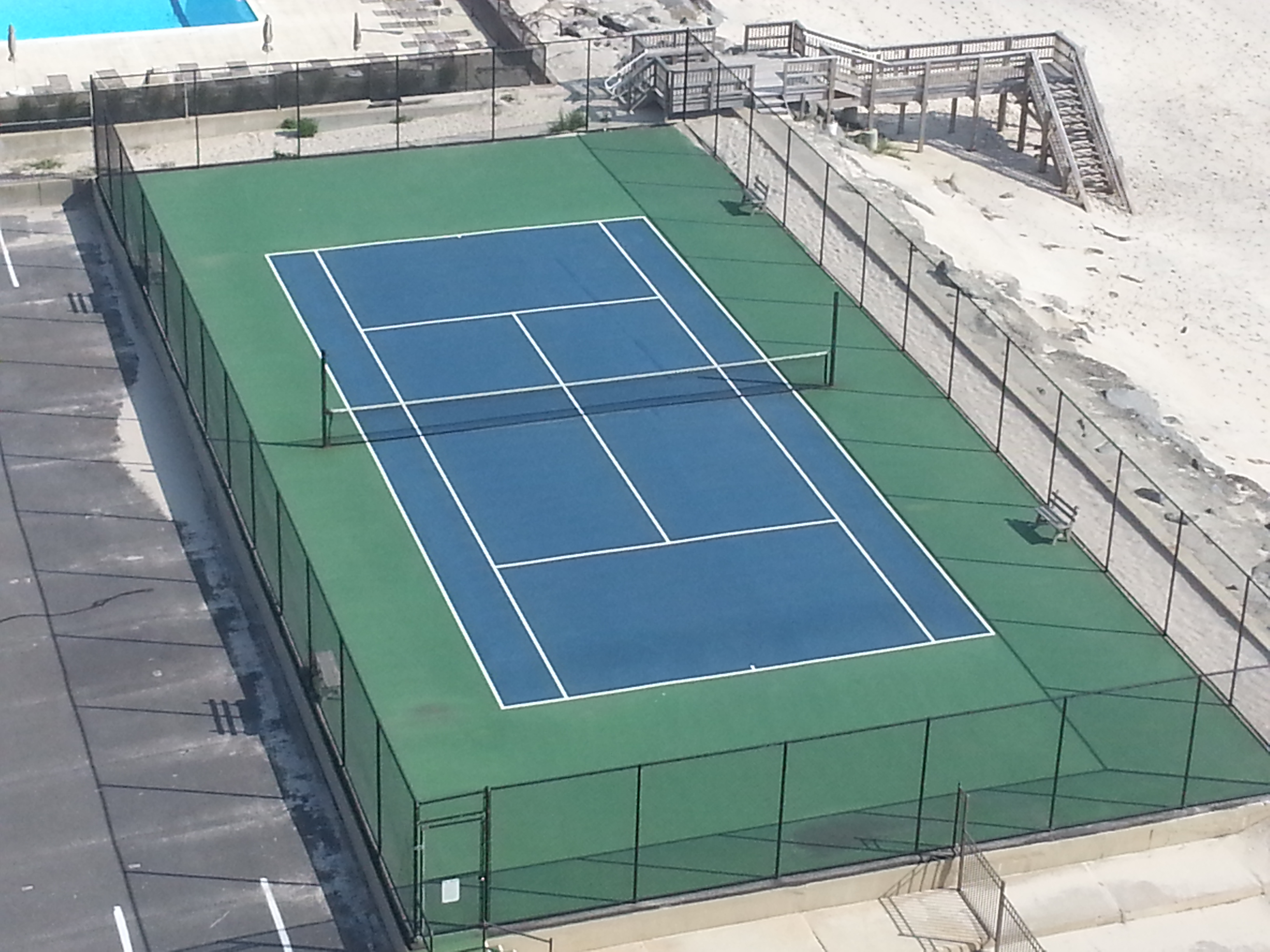 At the north end of the property next to the beach is this tennis court.