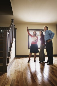 Realtor Leading Couple Through House