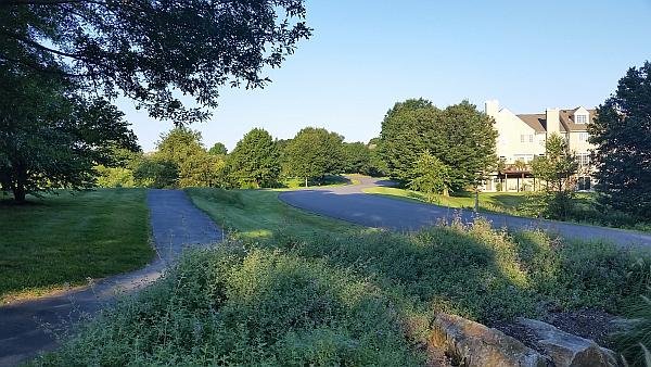 Walking path and street within The Knolls of Birmingham community.