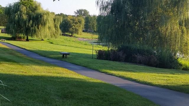 Walking path along a greenway in The Knolls of Birmingham community.
