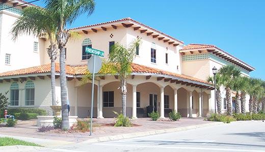 Corner of Friendship Lane in Sebastian, Florida featuring classic Mediterranean architecture