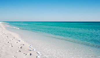 White sand beach with crystal clear blue water