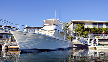Large white yacht at personal dock