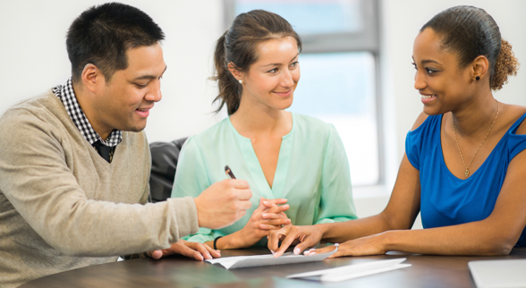 Image of Couple Signing Contract with a Realtors
