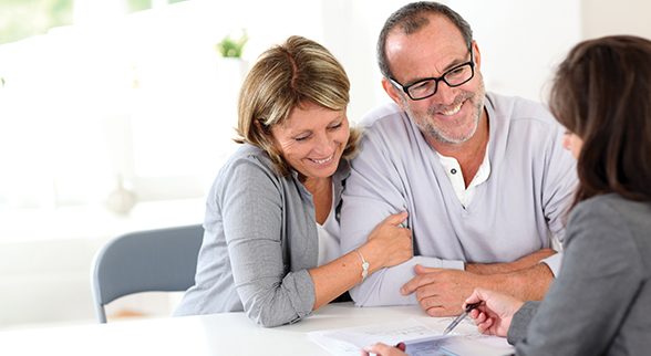 Older Couple Looking at Paperword with Real Estate Agent