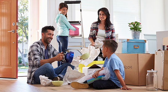 Image of Family Moving Into Their New Home