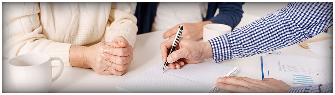 Image of a Senior Couple Man and Woman signing