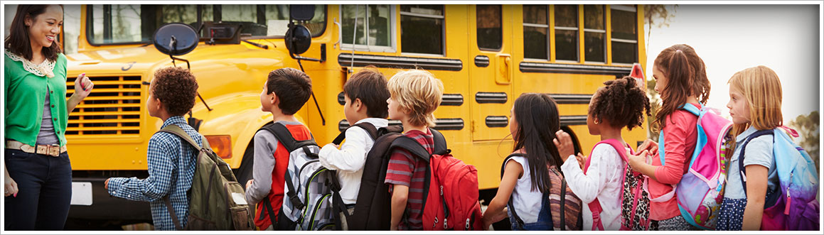 Image of children getting on a school bus
