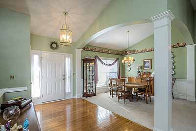 Entryway at true-ranch home with 3-car garage at 14080 S Alden Ct, Olathe, KS 66062