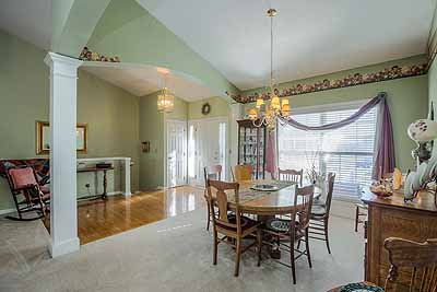 Formal Dining Room and entry at  true-ranch home with 3-car garage at 14080 S Alden Ct, Olathe, KS