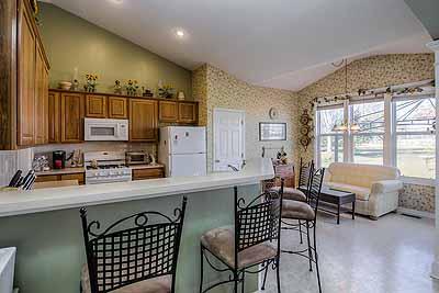 Olathe true-ranch home with 3-car garage at 14080 S Alden Ct, Olathe, KS 66062