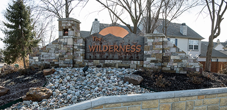 Monument Sign for The Wilderness neighborhood