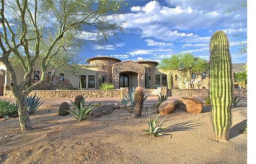 Exterior of luxury home in desert with cacti in the foreground