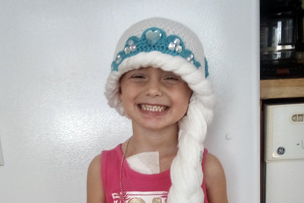 alexis little girl smiling knit hat