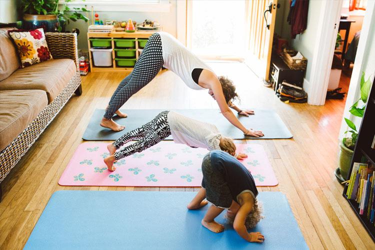 family doing yoga living room