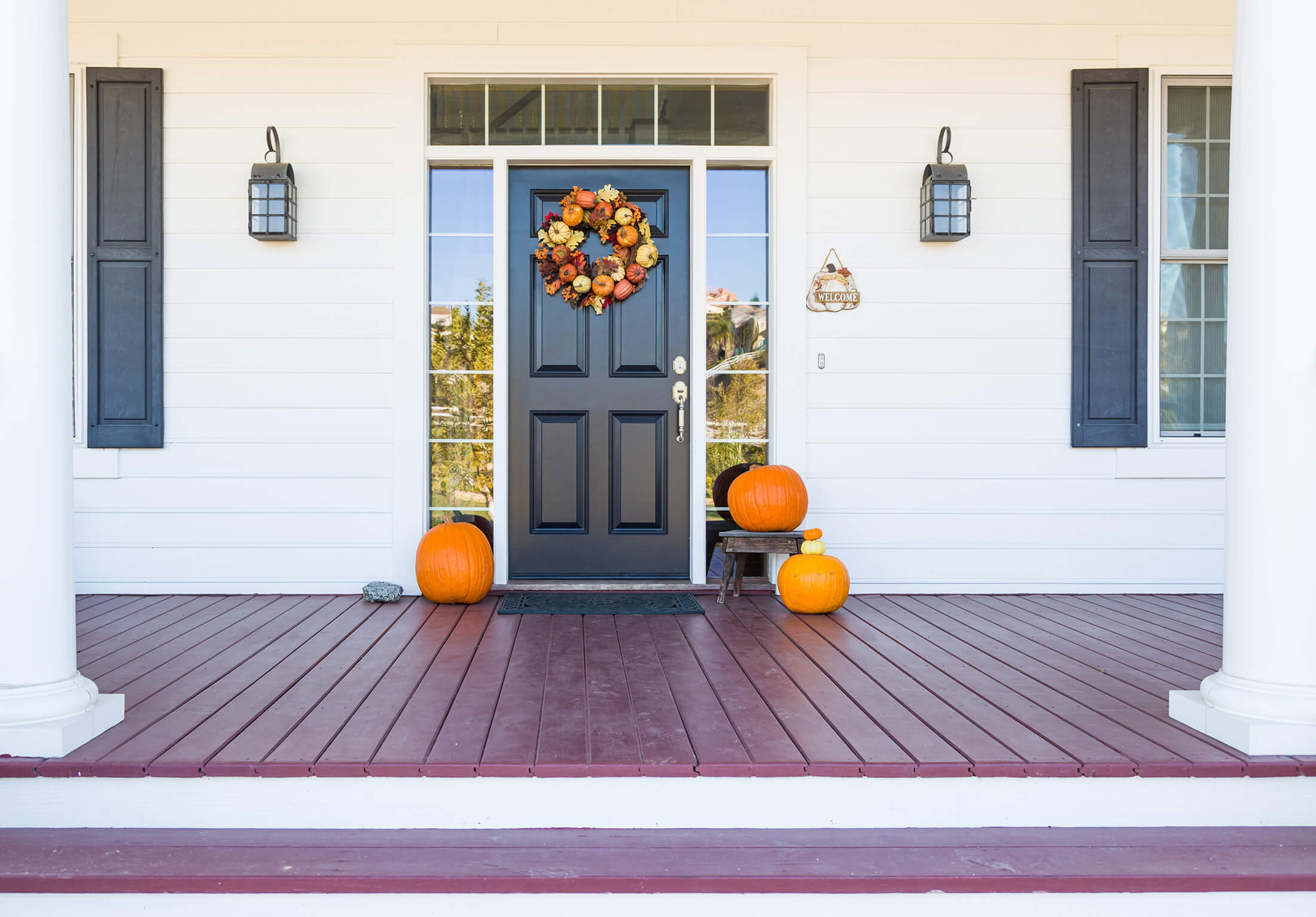 Holiday Fall front porch Halloween decorations