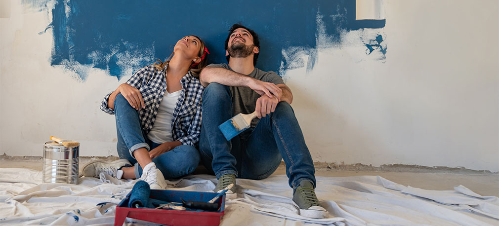 Couple taking a break from painting room
