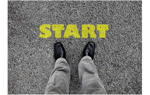 standing on street infront of start text in yellow