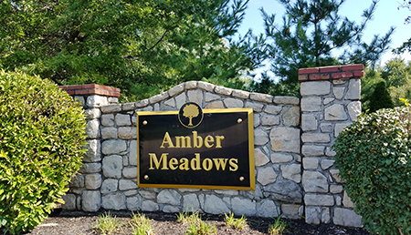 Entrance monument at Amber Meadows
