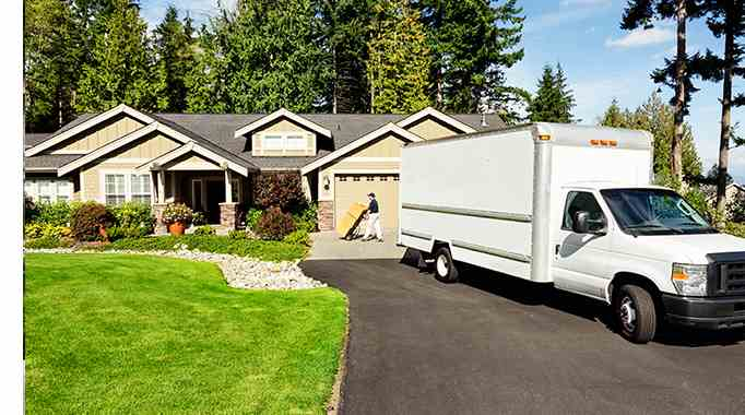 Moving truck in front of residential home