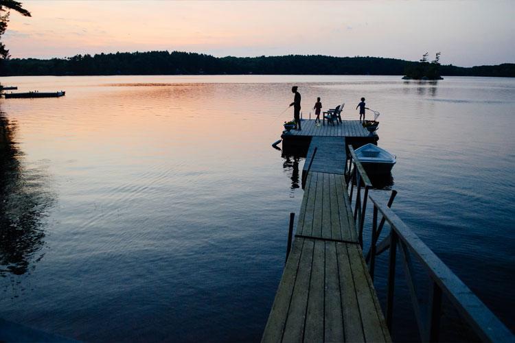 family on dock sunset