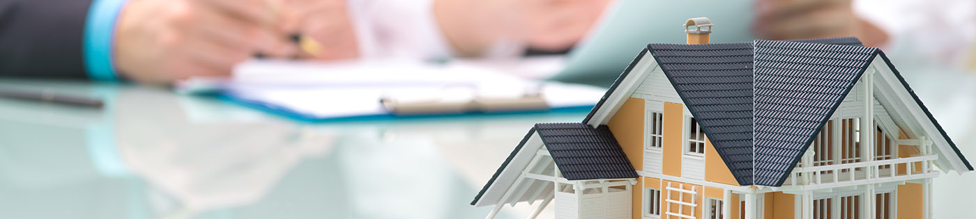 model of a house on conference room table