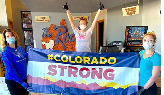 People holding Colorado Strong sign