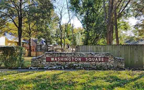 The Washington Square monument sign on West 79th Street in Lenexa, Kansas