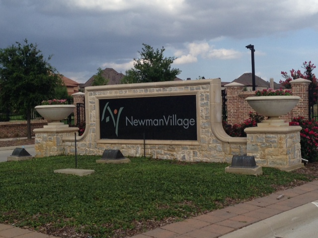 Newman village entry