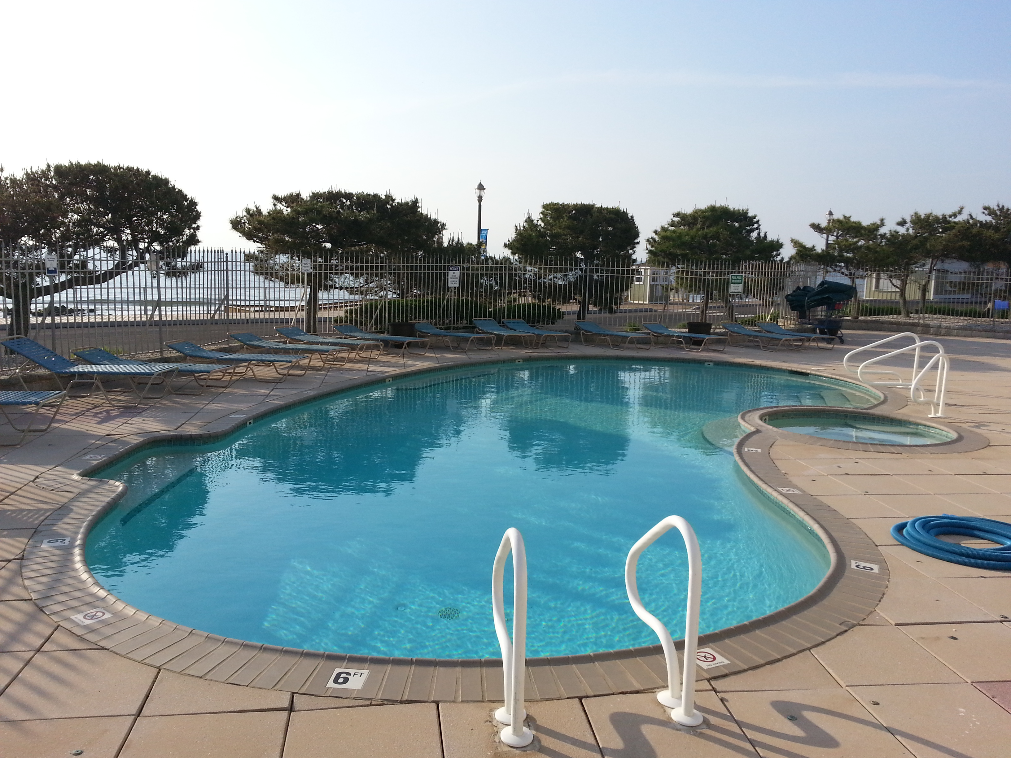 At the east end of the building overlooking the ocean, Ocean Plaza has a beautiful heated pool.