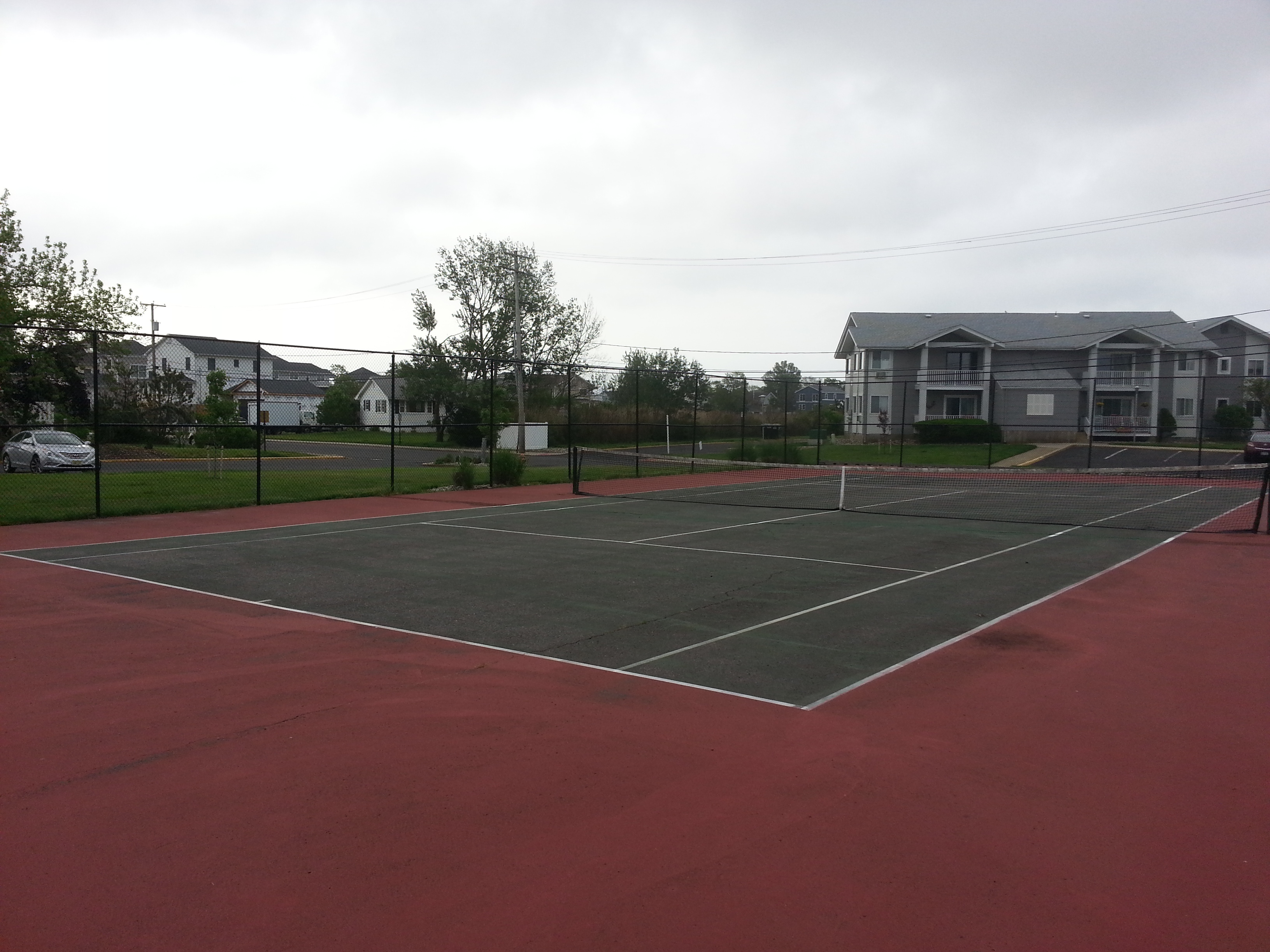 Sands Point South has a tennis court right by the pool.