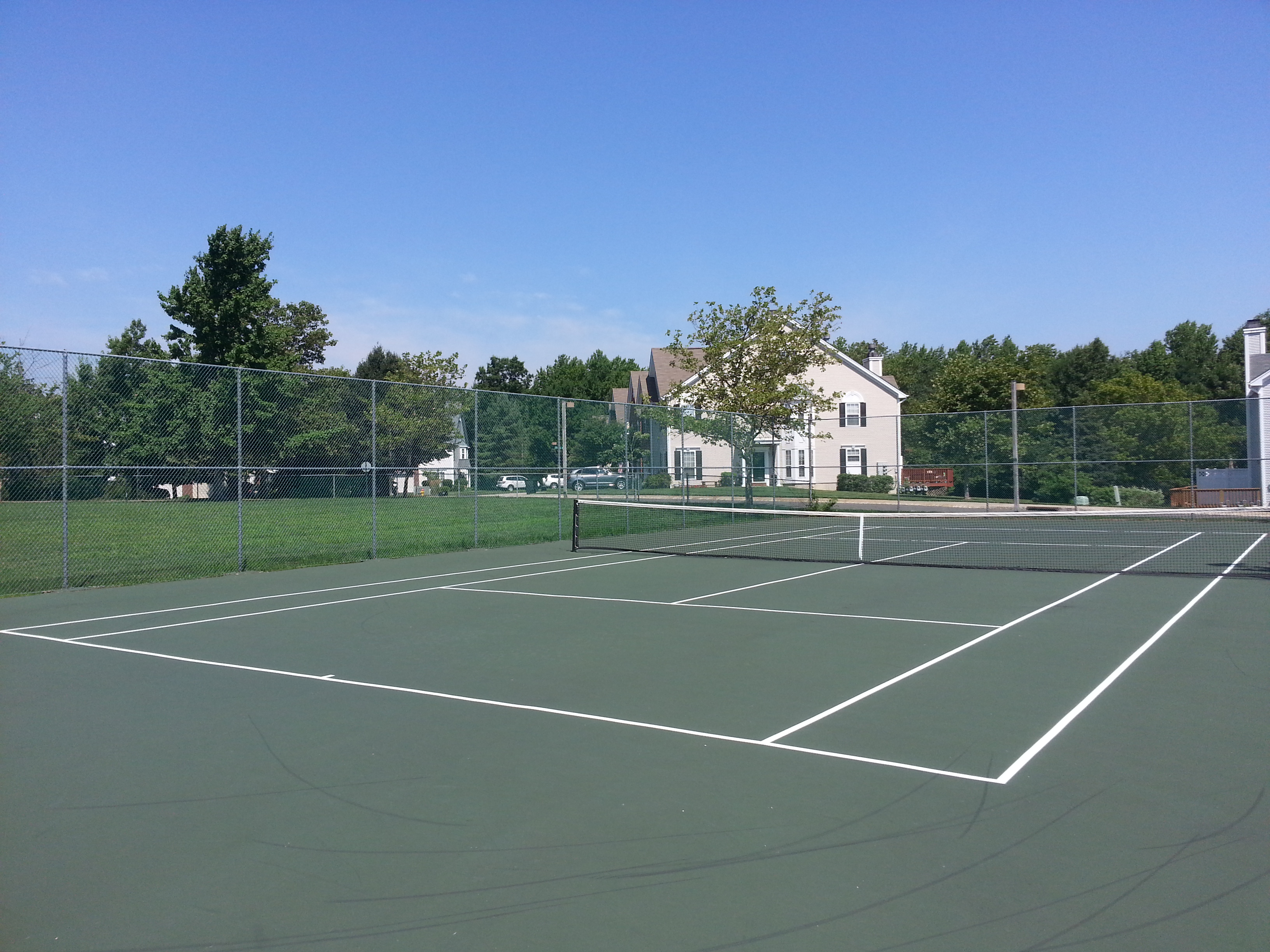 Among The Orchards amenities is this centrally located tennis court.