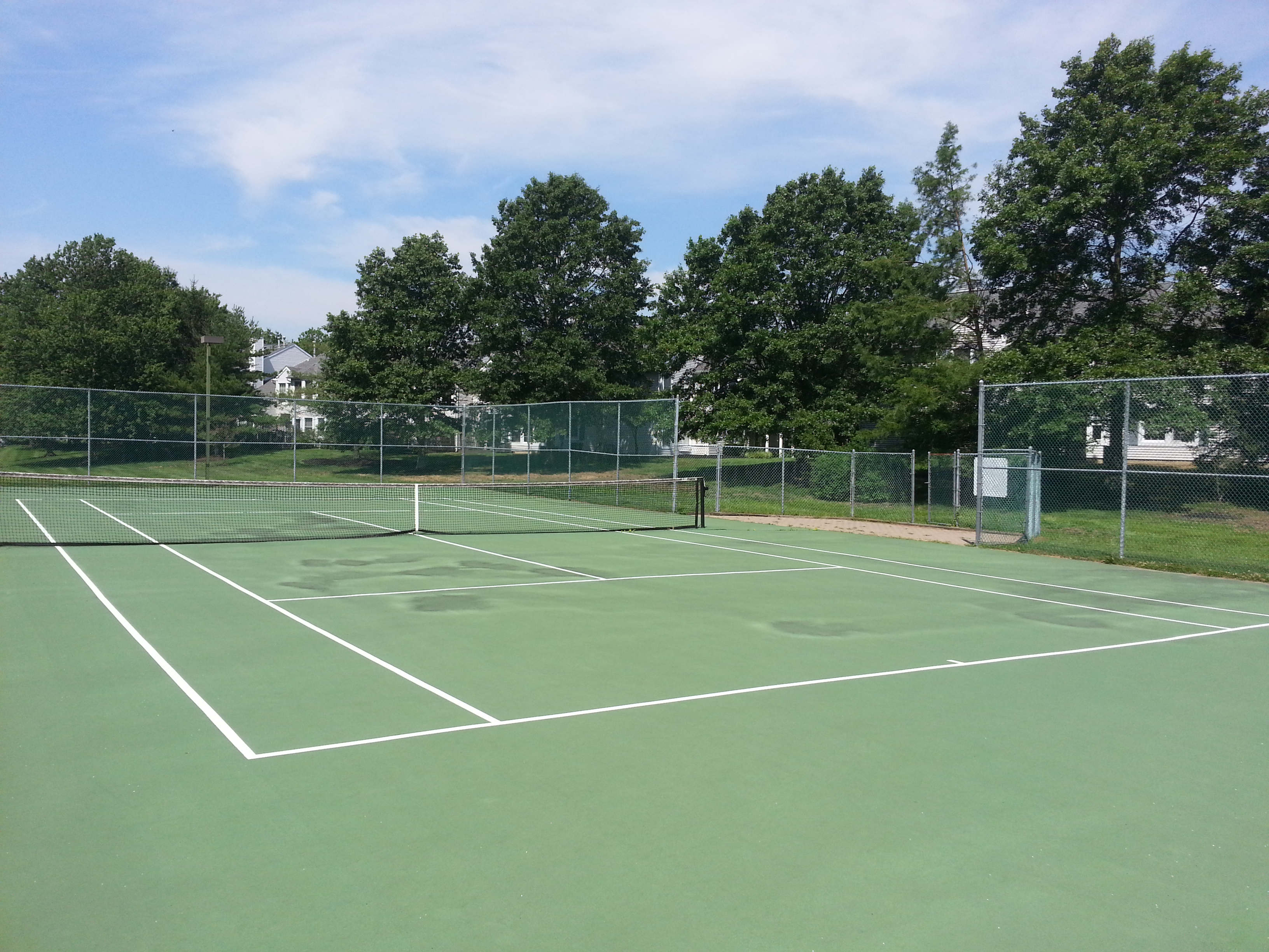 This tennis court is among the amenities at the Villas at Poplar Brook in Ocean Twp.