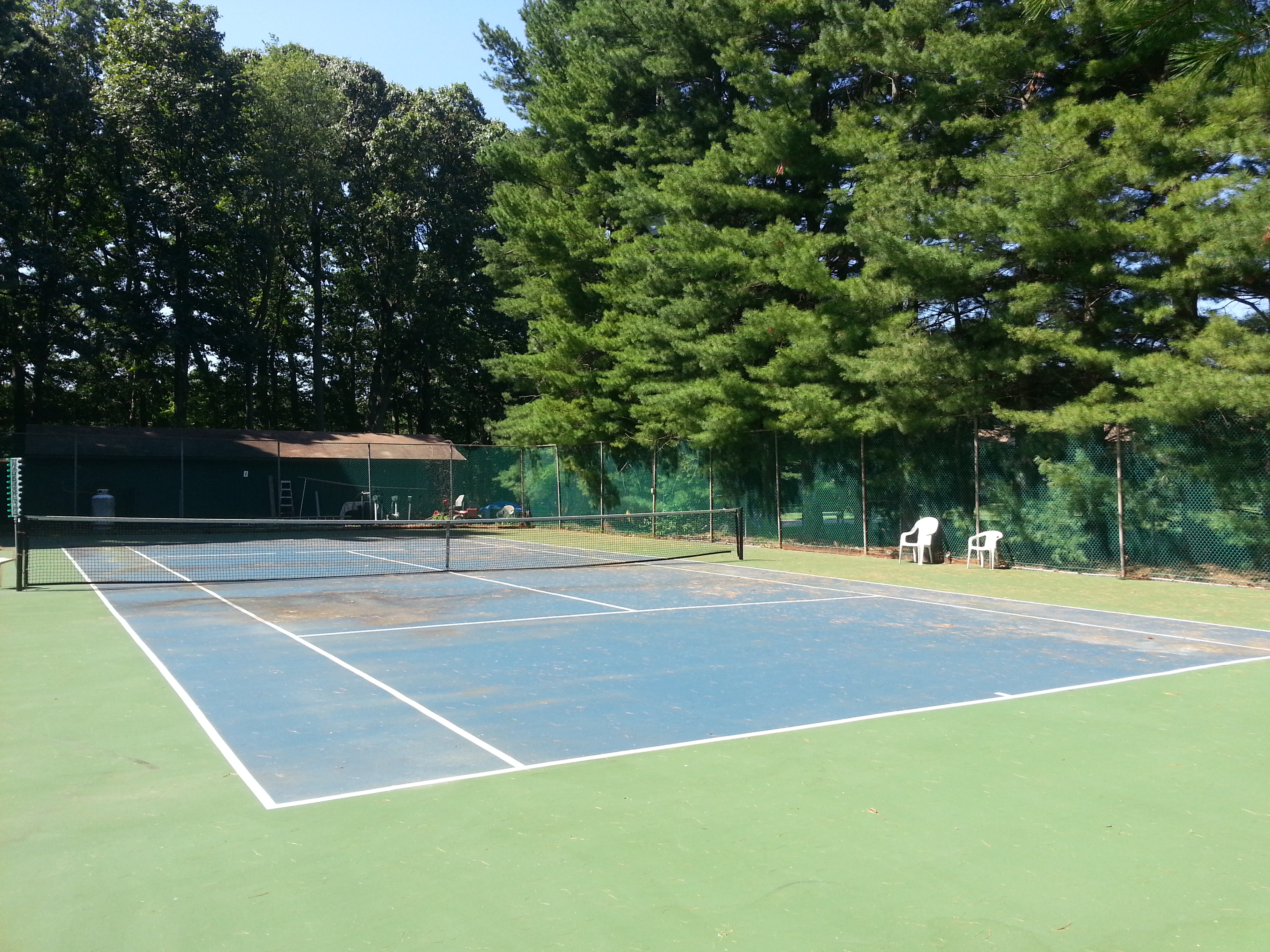 Shadow Lake Village has two tennis courts, pictured here, located near the clubhouse and pool.