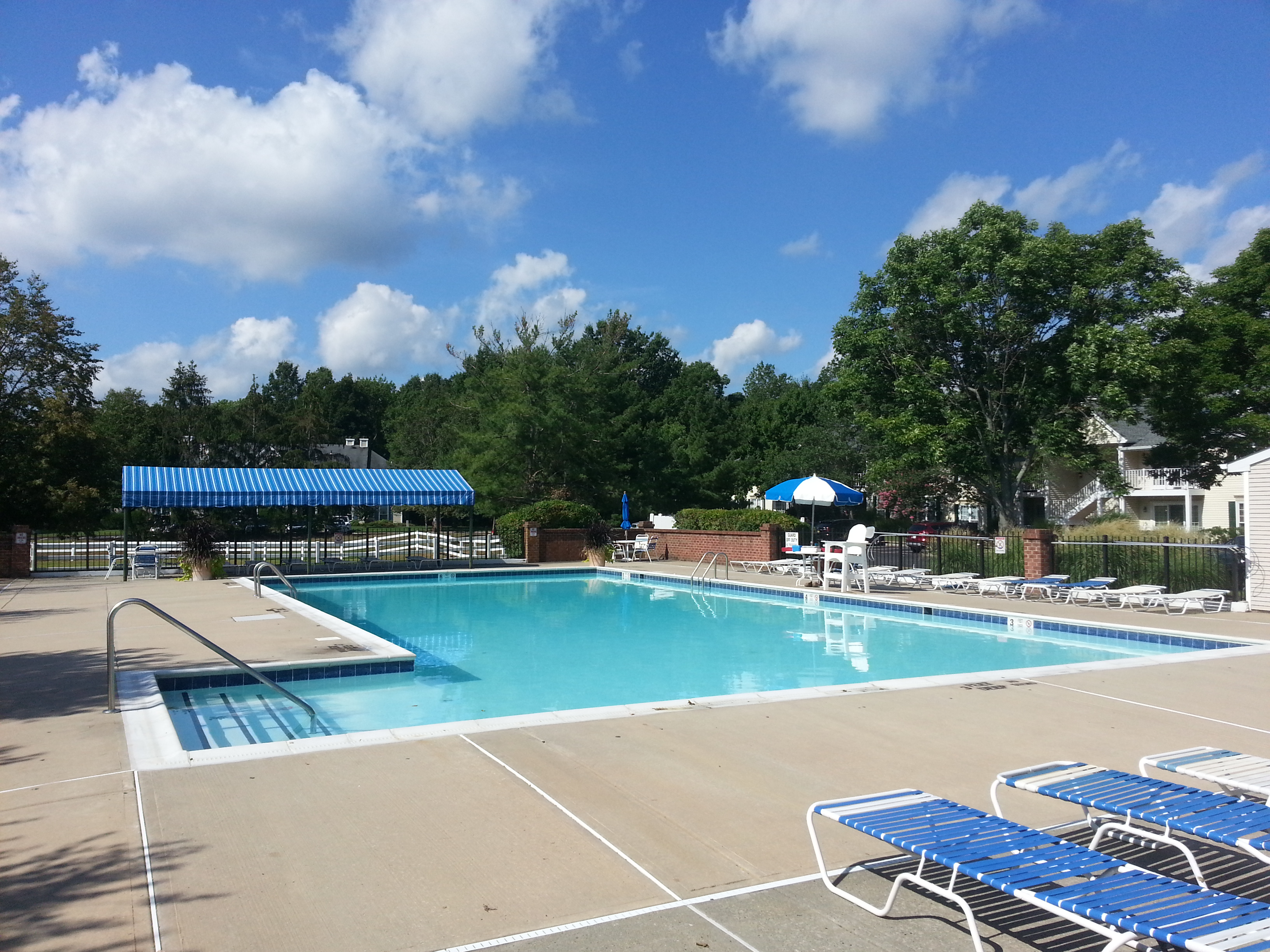 Among the amenities at Society Hill in Tinton Falls is the beautiful community pool pictured here.